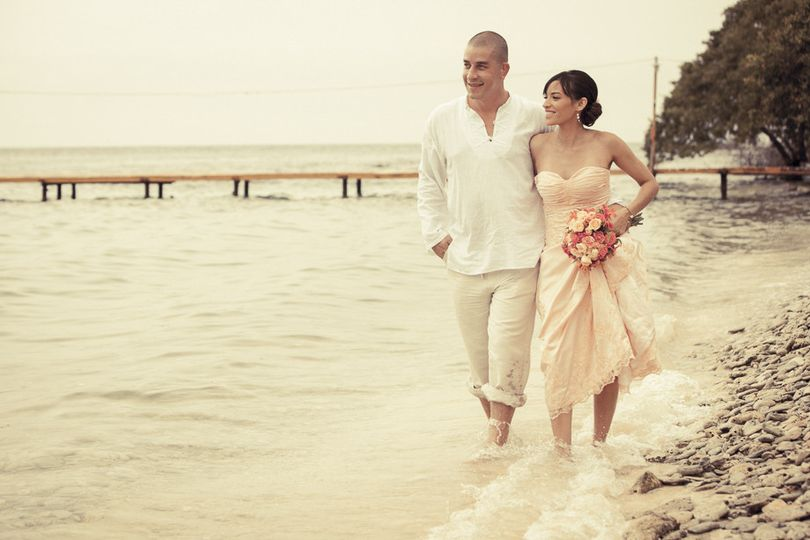 Wedding couple walking at the beach