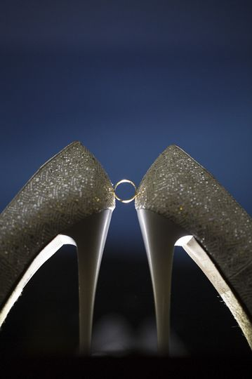 Wedding ring between shoes