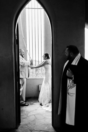 Cam watching his happy couple ring the wedding bell at Chapel Dulcinea