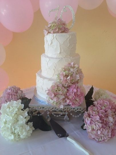 Wedding cake with cool tone flowers