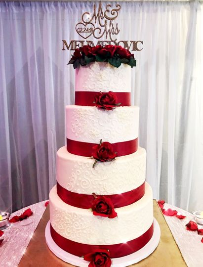 Wedding cake with red ribbons