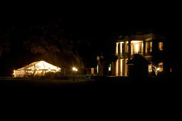 The Main House and tent at night.