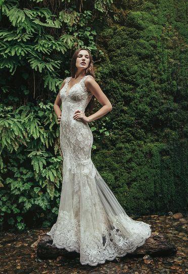 Bristol   Ivory Alençon lace gown with a beaded lace illusion back. Mink crepe back satin provides a...