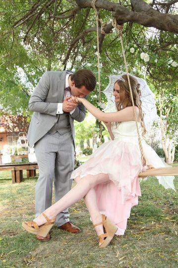 Groom kissing his bride's hand