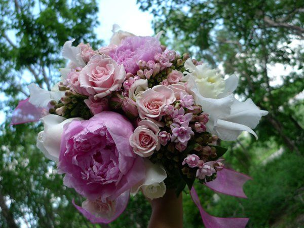 Pink and white bridal bouquet of peonies, roses, spray roses and bouvardia, with a cute crystal...
