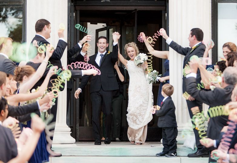 Clare and Brandon are greeted by colorful slinkies as they leave the Toledo Art Museum after their...