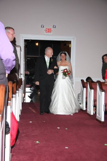 Bride and father entering church.