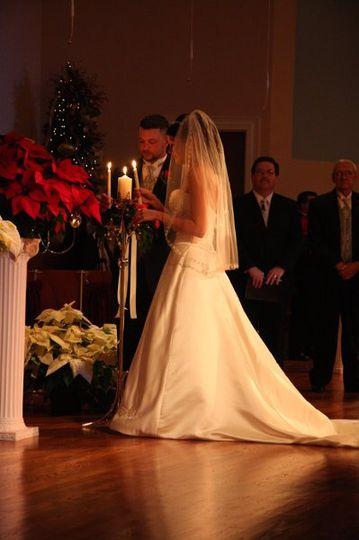 Bride and Groom lighting unity candle.