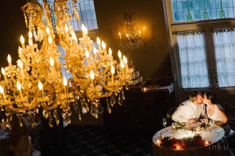 Couple kissing underneath the chandelier