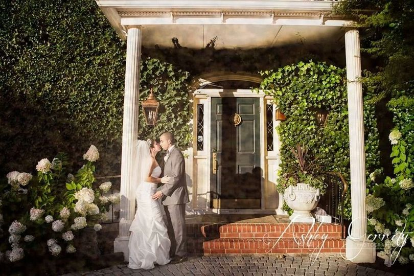 Couple kissing out the front steps