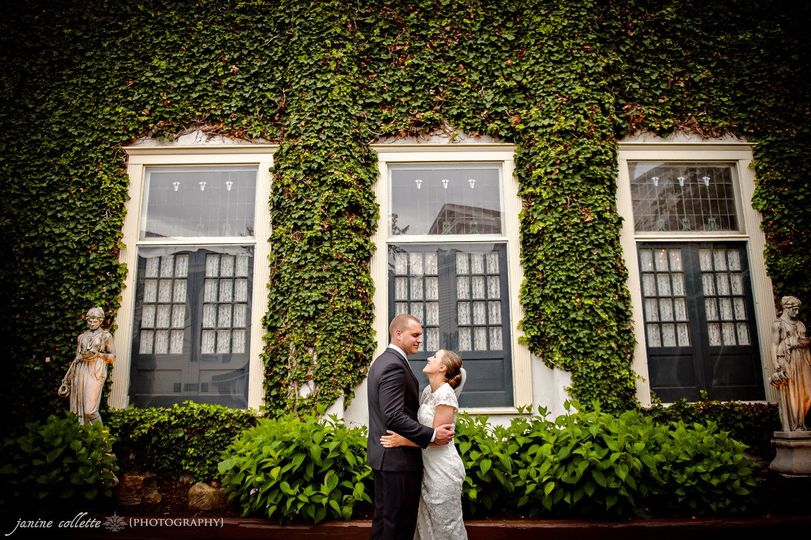 Couple portrait by a plant wall
