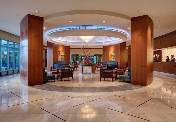 Our greatroom lobby provides a warm welcome to guests and valet parking makes coming downtown a...