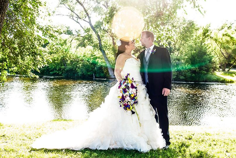 Bride and groom with sunflare