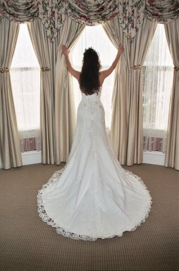 Bride looking out window for groom