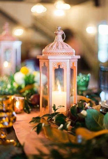 Lantern & garland centerpiece on farm table