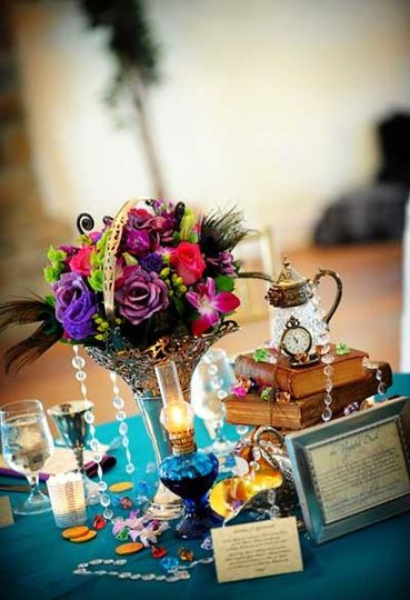 Wedding table centerpiece with books, antique silver and oil lamp