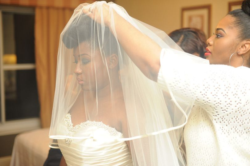 Assisting the bride with her veil