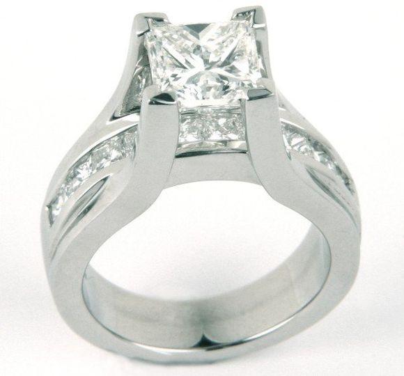 Princess Cut Diamond in Platinum Floating Setting with Princess Cut Diamonds flowing under center...