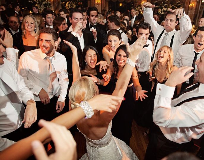 Guests having fun with bride