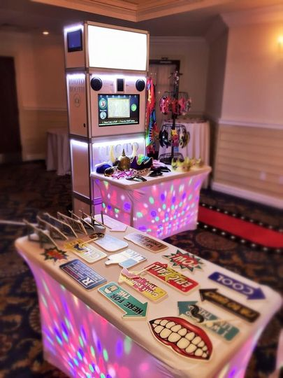 Open air photo booth includes 2 attendants, unlimited pictures, props, and a usb with all the...