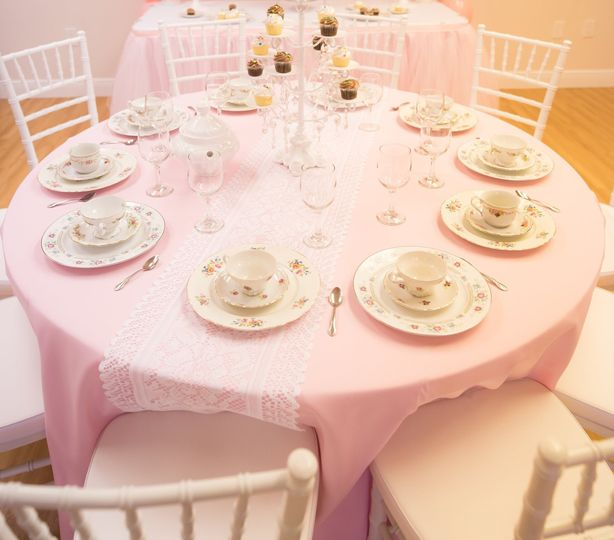 Tea party table set-up with light pink tablecloth, White lace table runner, and candelabra...
