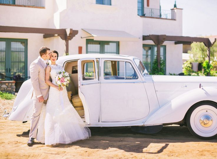 Couple and their bridal car