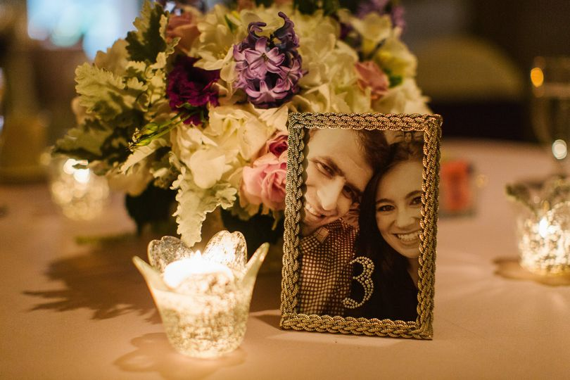 Flower centerpiece with couple's photo frame
