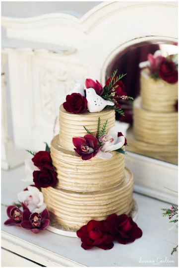 Wedding cake with deep red flowers
