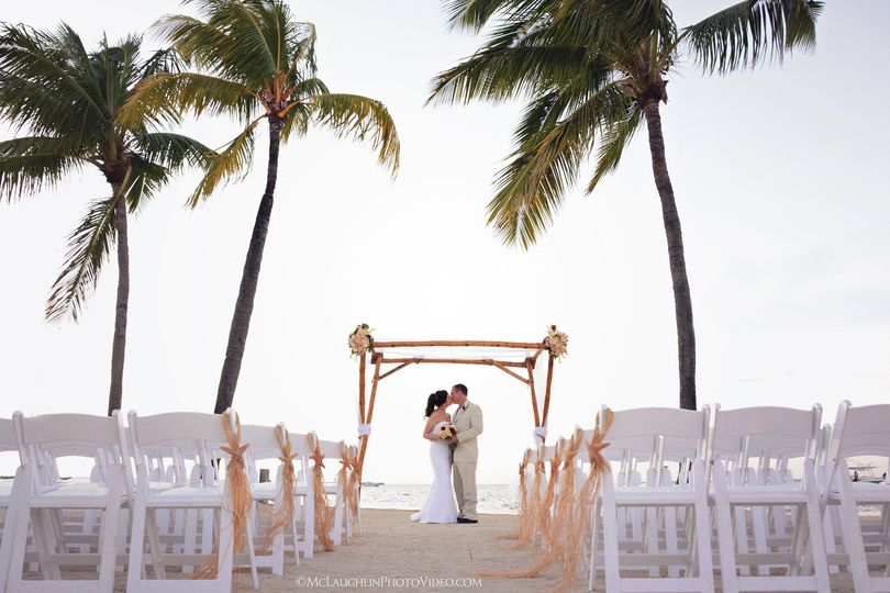 Bride and Groom at their Ceremony Site at the Key Largo Marriott