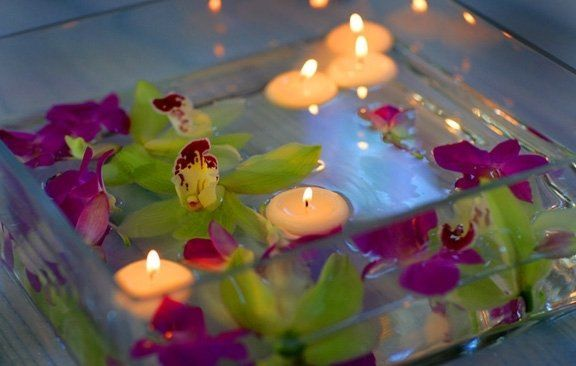 Floating orchids in low sqaure dish