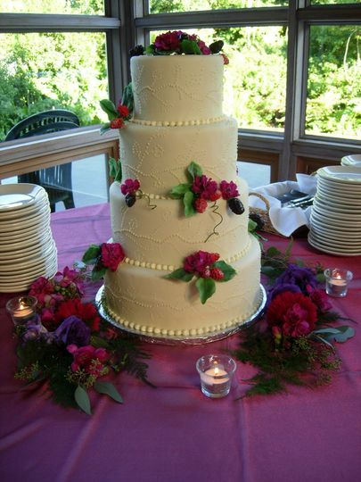 Four tier wedding cake decorated in red flowers
