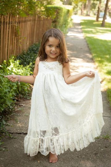 Soft and lovely lace halter style maxi!  Lined in cotton with a sheer ruffle hem that falls to the...