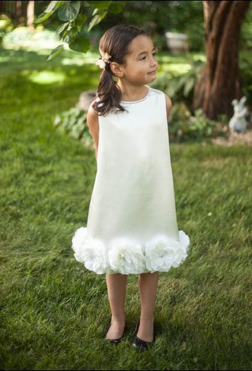 This is truly a simple yet stunning little dress!  The fabric has a beautiful texture similar to...