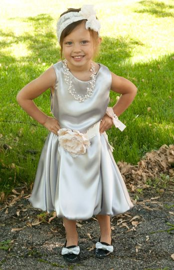 This is a lovely silver satin tea length dress!  The satin charmeuse drapes so beautifully and it's...