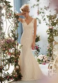 Beautiful lace gown by Mori Lee with low back priced at $438.00.