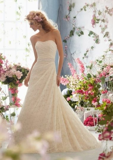Glamorous lace wedding gown with a pearl beaded belt that is included int this very affordable gown,...
