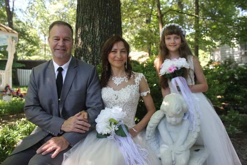 Newlyweds with the flower girl