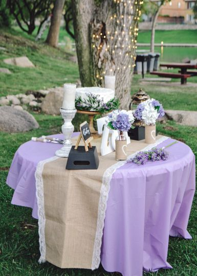 Cake table for a rustic outdoor reception.