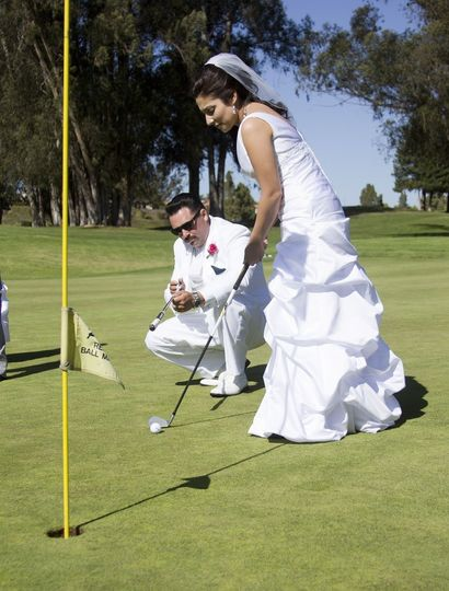 The couple playing golf