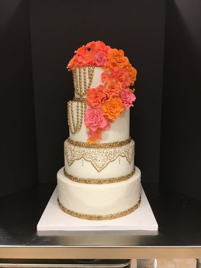 Gold Elegance Wedding Cake with Cascading Sugar Flowers