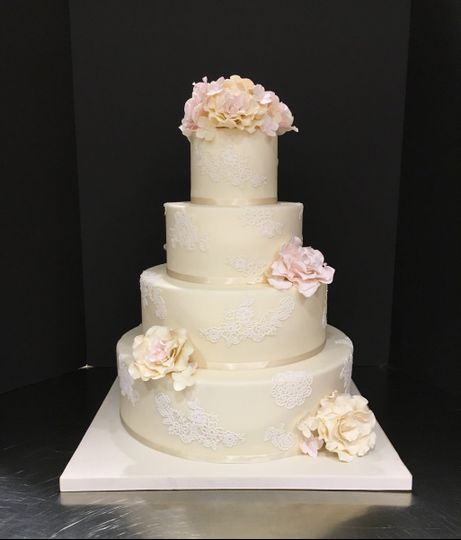 Ivory Wedding Cake with Lace Appliques and Sugar Roses