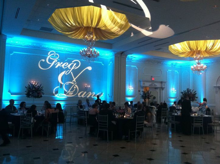 Blue uplights and monogram projection