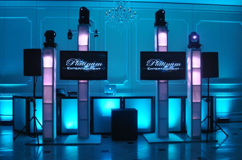 Booth setup with lights and screens