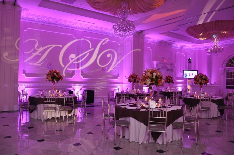 Pink uplights and monogram projection