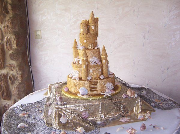 Sandcastle theme was this brides dream. We even made the topper.