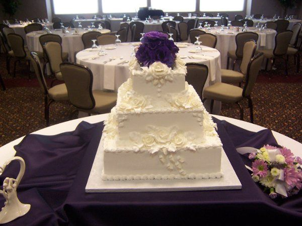 Fresh flowers accent this all white on white design.  A traditional cake that is a classic