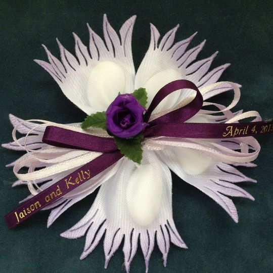 Corvara wildflower lavender flower favor with Jordan almonds, custom courgette accents. See...