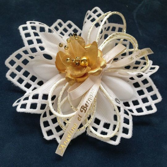 Lucca Italian ribbon flower with gold flower and personalized accents. See Confettiflowers.com