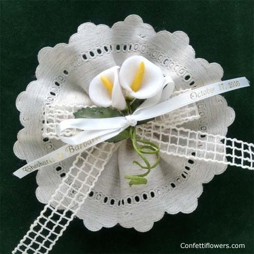 Matera natural ribbon flower favor with calla lilies and rustic ribbon. See Confettiflowers.com