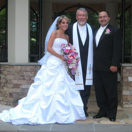 The newlyweds and the officiant